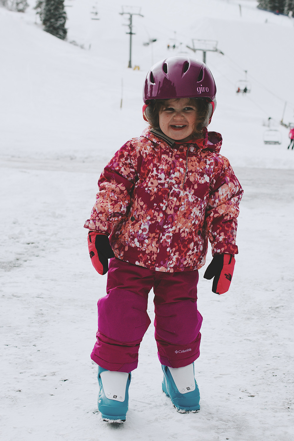 A child smiles for the camera ready to go skiing at Copper Mountain in Summit County, Colorado