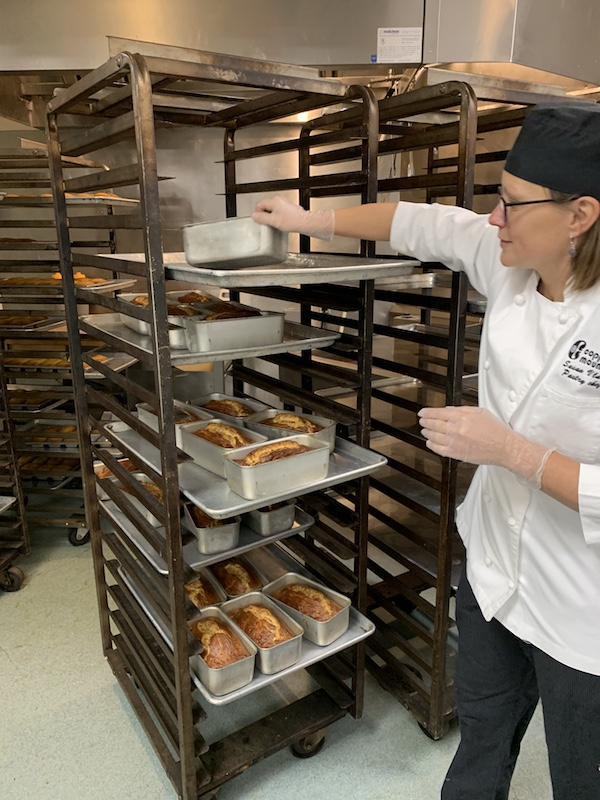 Pastry Chef Susan Vlass examines bread in Copper Mountain's bakery
