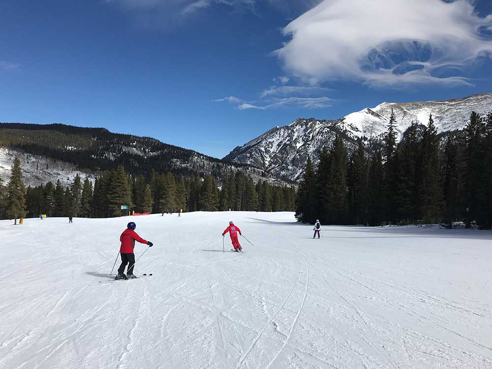 Ski and Ride School student head down a mellow slope at Copper Mountain
