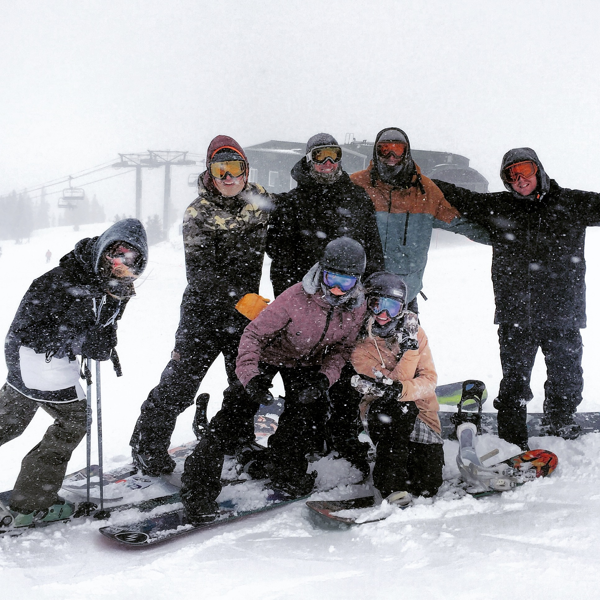 A group of friends enjoy a powder day snowboarding at Copper Mountain