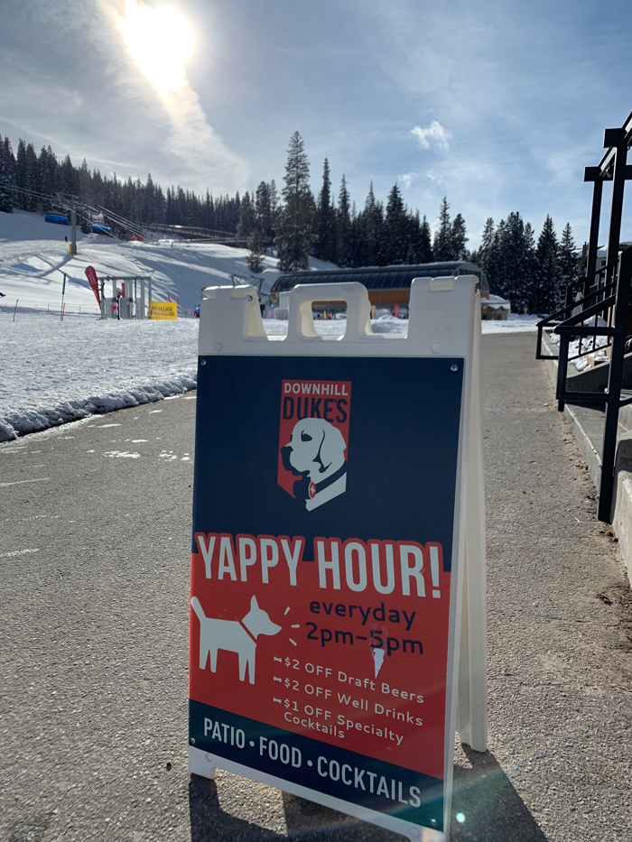 A sign detailing Yappy Hour at Downhill Duke's at Copper Mountain