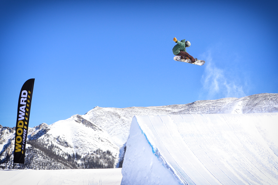 Snowboarder competes in 10 Barrel Hella Big Air at Copper Mountain