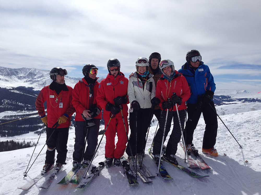 Group of Over the Hill Gang Skiers stand on top of Copper Mountain