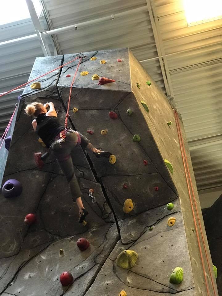Childcare Manager Jennifer Young rock climbs