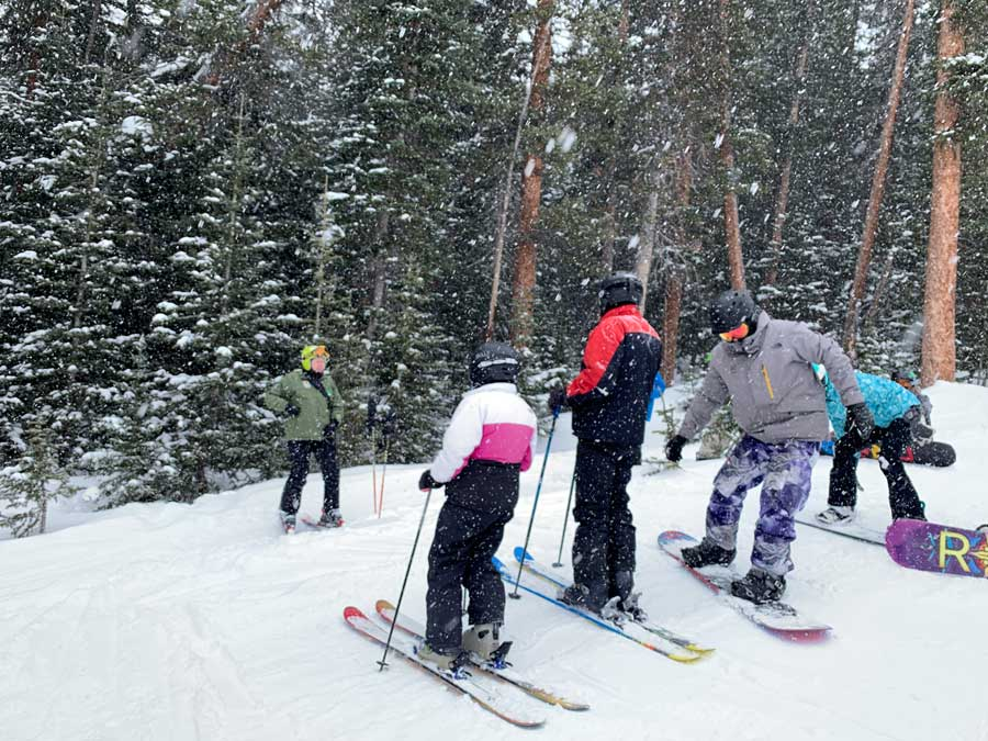 A group listens to ranger during Ski with a Ranger at Copper Mountain