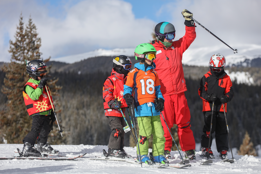 An instructor discusses terrain with student at Copper Mountain